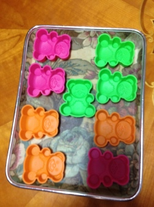 Using silicone cake moulds for the soap - making very cute teddy bears.