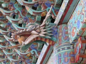There are quite a few dragon images carved into the wooden pillars.