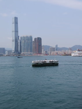 The Star Ferry with Kowloon skyline in the background.