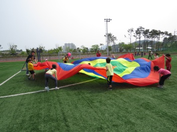 Never too old to play with a brightly coloured parachute.