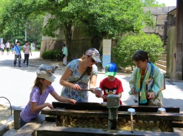 Trying out the water from the castle's well.