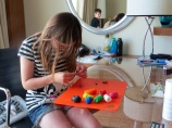 Katrine concentrating hard in her creations.